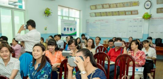 Teachers experience virtual reality using VR Headset